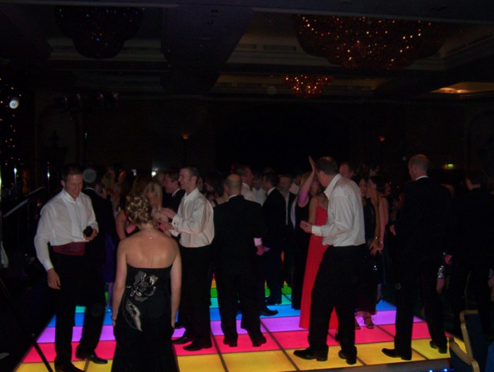 People on Colourful Light Up Dance Floor
